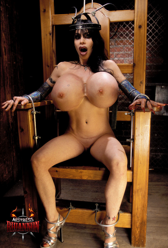 Brunette riding dildo on table