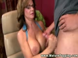 Naughty MILF with glasses jerking cock