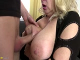 Mother with hot pair of boobs fucking young guy