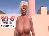 Blonde MILF showing her tist at the pool