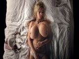 Horny blonde with gigantic boobs plays with her pussy