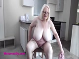 Squeezing her granny boobs