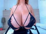 Mature women shows her massive breasts